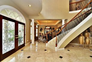 Traditional Entryway with can lights, High ceiling, French doors, picture window, Columns, complex marble floors