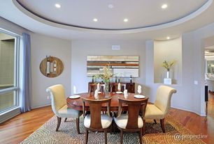 Contemporary Dining Room with Laminate floors, Standard height, Carpet, can lights, picture window