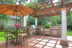 Rustic Patio with Outdoor kitchen, Rosedown cast aluminum patio swivel bar stool, exterior brick floors, Trellis