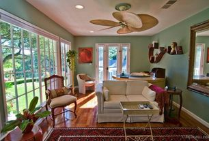Eclectic Home Office with Hardwood floors, Ceiling fan, French doors