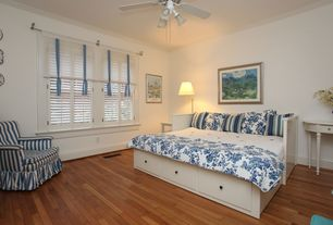 Cottage Guest Bedroom with Bamboo floors, Ceiling fan, Crown molding, flush light, Hardwood floors