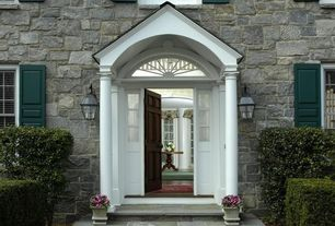 Traditional Front Door with exterior tile floors, Arched window, Transom window