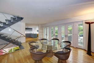 Contemporary Dining Room with French doors, can lights, Hardwood floors, Standard height