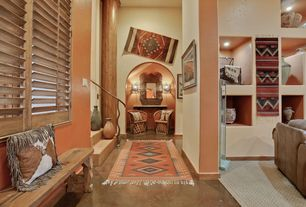 Eclectic Hallway with High ceiling, Concrete floors, Columns, Wall sconce