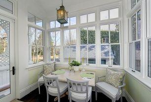 Traditional Dining Room with Hardwood floors, Pagoda Lantern in Green, Transom window, Pendant light, Chair rail