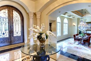 Traditional Entryway with Wall sconce, Concrete tile , Glass panel door, High ceiling, Chandelier, Arched window