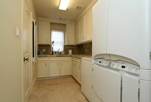 Traditional Laundry Room with sandstone floors, flush light