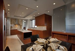 Contemporary Kitchen with Flush, Casement, U-shaped, Standard height, Concrete floors, full backsplash, Wall Hood, can lights