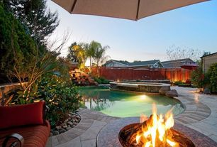 Modern Swimming Pool with Pool with hot tub, Fence, Fire pit, exterior tile floors, exterior brick floors, Raised beds