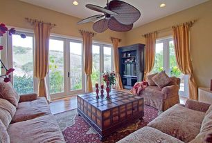 "Mediterranean Living Room with Ceiling fan, Laminate floors, Fanimation 52"" Islander 5 Bamboo Blade Ceiling Fan, French doors"