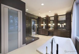 Contemporary Master Bathroom with Concrete floors, Benkei Freestanding Tub Faucet and Hand Shower, European Cabinets
