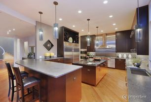 Contemporary Kitchen with double bowl undermount sink, extra large built in refrigerator, under cabinet lights, Wall Hood