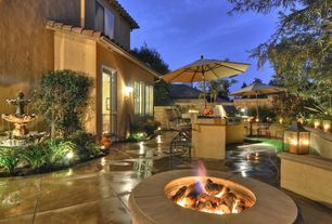 Mediterranean Patio with Outdoor kitchen, French doors, exterior concrete tile floors, Fire pit, specialty window