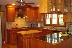 Traditional Kitchen with Stone Tile, Wood counters, Hardwood floors, Flat panel cabinets, Kitchen island, Formica counters