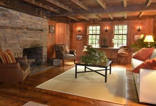 Rustic Living Room with Turner Square Arm Sofa, Lindrum Leather Armchair, Exposed beam, Wall sconce, Area rug