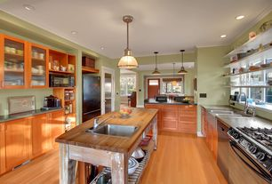 Traditional Kitchen with dishwasher, Drop-in sink, Standard height, Pendant light, Bamboo floors, Flat panel cabinets, Flush