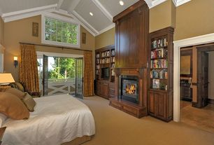 Traditional Master Bedroom with High ceiling, Carpet, Built-in bookshelf, French doors, Transom window, metal fireplace