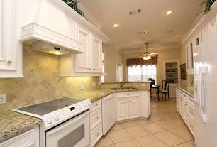 Traditional Kitchen with Stone Tile, can lights, Galley, flush light, Simple granite counters, full backsplash, Crown molding