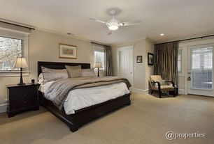 Traditional Guest Bedroom with Carpet, Ceiling fan, flush light, Crown molding, specialty door