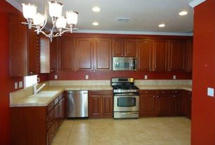 Traditional Kitchen with travertine tile floors, stone tile floors, Crown molding, can lights, Standard height, Chandelier