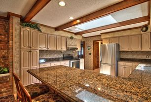 Country Kitchen with U-shaped, Complex granite counters, Complex Granite, Undermount sink, Breakfast bar, Exposed beam