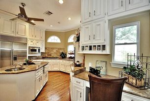 Traditional Kitchen with Formica counters, full backsplash, specialty window, Crown molding, Breakfast bar, can lights, Slate