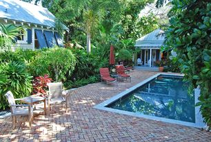 Eclectic Swimming Pool with exterior brick floors, French doors, Lap pool