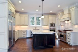 Traditional Kitchen with U-shaped, Custom hood, Raised panel, Undermount sink, Pendant light, Complex marble counters