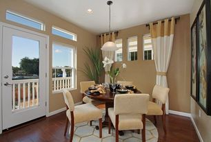 Contemporary Dining Room with French doors, Pendant light, Hardwood floors, interior wallpaper