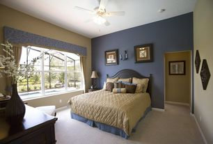 Traditional Guest Bedroom with flush light, Ceiling fan, Carpet, Wall sconce