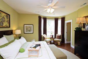 Modern Guest Bedroom with Bay window, Ceiling fan, Carpet, Laminate floors