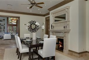 Contemporary Dining Room with Ceiling fan, terracotta tile floors, stone fireplace, Arched window, Carpet, French doors