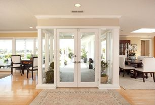 Modern Entryway with Crown molding, French doors, Hardwood floors