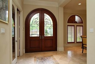 Traditional Entryway with Crown molding, Glass panel door, High ceiling, French doors, complex marble floors, Arched window