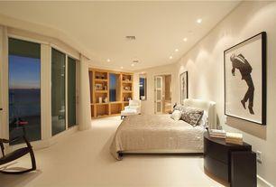 Contemporary Guest Bedroom with Carpet, Built-in bookshelf, Glass panel door