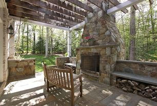 Rustic Patio with outdoor pizza oven, exterior stone floors, Trellis