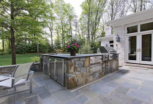 Traditional Patio with Glass panel door, Concrete counters, Custom hood, Standard height, L-shaped, stone tile floors