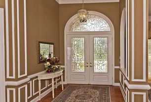 Traditional Entryway with Wainscotting, Pendant light, Crown molding, Laminate floors, Chair rail, Glass panel door