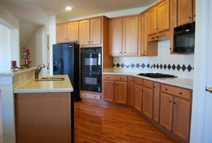 Traditional Kitchen with can lights, Large Ceramic Tile, Standard height, Built In Refrigerator, electric cooktop, Galley
