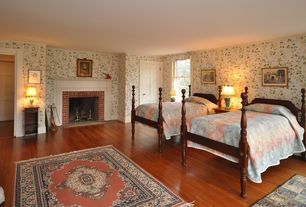 Country Guest Bedroom with six panel door, Carpet, Standard height, Fireplace, Glass panel door, interior wallpaper