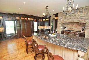 Mediterranean Kitchen with Undermount sink, Custom hood, L-shaped, Kitchen island, Wolfe - 6 burner + griddle, double oven