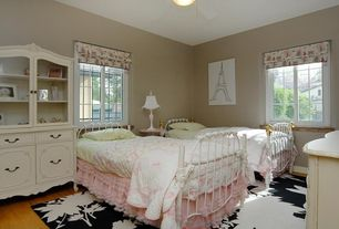 Cottage Kids Bedroom with Carpet, Laminate floors, Ceiling fan