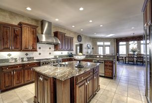 Mediterranean Kitchen with Pental rocky mountain polished granite, Onyx counters, Kitchen island, Undermount sink, L-shaped