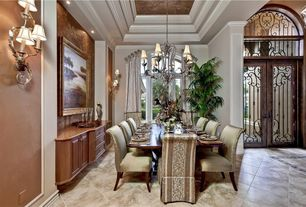 Traditional Dining Room with Built-in bookshelf, High ceiling, picture window, Crown molding, Wall sconce, Glass panel door