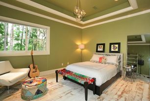 Eclectic Guest Bedroom with Crown molding, specialty window, Hardwood floors, Pendant light, Standard height