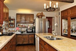 Cottage Kitchen with Kitchen island, Flat panel cabinets, large ceramic tile counters, Glass panel, High ceiling, Casement