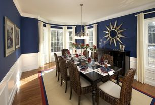 Contemporary Dining Room with Laminate floors, Standard height, Wainscotting, Casement, Crown molding, Pendant light, Carpet