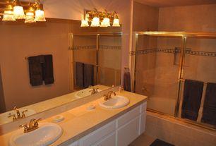 Contemporary Master Bathroom with Wall sconce, Built-in bookshelf, travertine tile floors, Standard height, stone tile floors