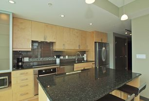 Contemporary Kitchen with Flush, Kitchen island, Glass Tile, European Cabinets, Simple granite counters, Undermount sink