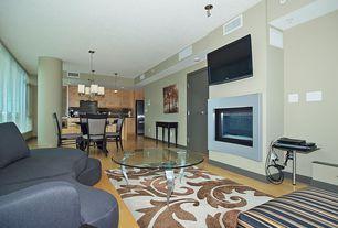 Modern Living Room with picture window, Laminate floors, Carpet, flat door, Pendant light, Columns, Wainscotting, can lights